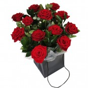 Dozen red roses arranged in a gift box